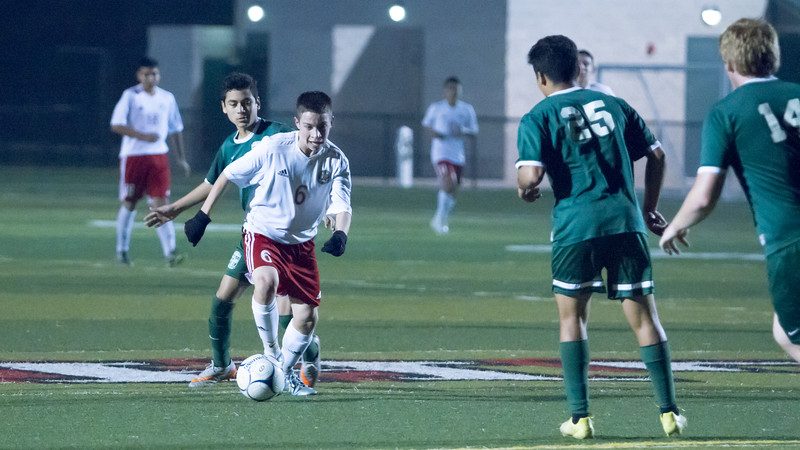 Lindsay defeated Garces Memorial 2-0 in CIF Division IV playoff action to advance to the quarterfinals against the Delano Tigers. Here Marcos Cabellos brings the ball up the middle of the Garces Rams defense.