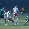 Lindsay defeated Garces Memorial 2-0 in CIF Division IV playoff action to advance to the quarterfinals against the Delano Tigers. Cardinal Marcos Ceballos (center) attempts to make a pass as a host of Garces defenders  converge on the ball.