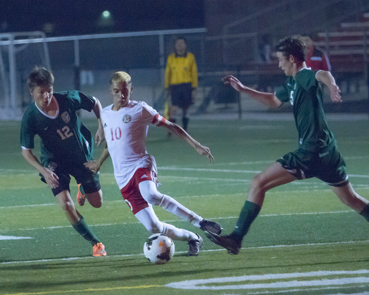 Lindsay defeated Garces Memorial 2-0 in CIF Division IV playoff action to advance to the quarterfinals against the Delano Tigers. Here Cardinal Kevin Ceballos (10) attempts to maneuver through Garces' aggressive defense.