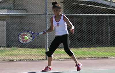 Juana Moreno of Lindsay returns a shot  Granite Hills during their tennis match on Thursday, August 28th.