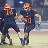 Woodlake FB Victor Rojas (30) rushes past his offensive lineman Angel Castillo (72) for additional yards in the Tigers 14-6 victory over the Granite Hills Grizzlies in the annual Battle for the Belt rivalry game in Woodlake.