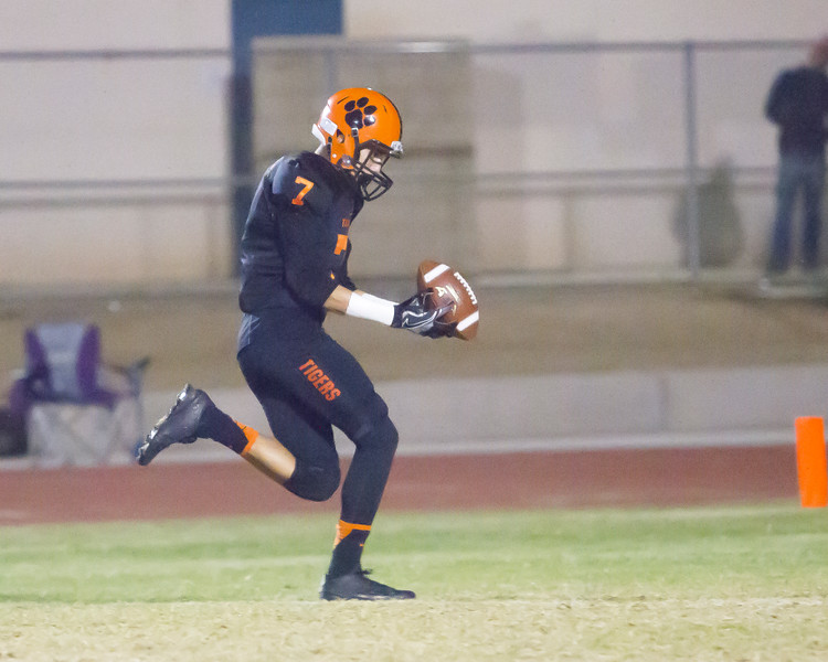 Woodlake Tiger WR Henry Hagen takes their first offensive play of the game for Woodlake to the end zone to give the Tigers and early 7-0 lead over the visiting Granite Hills Grizzlies.  Woodlake would go on to win by a 14-6 score in the annual Battle for the Belt.