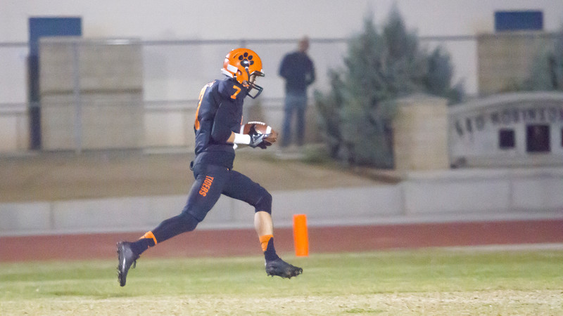 Woodlake Tiger wide receiver Henry Hagen (7) races to the end zone on their first play from scrimmage in Friday nights contest against the Granite Hill Grizzlies. Woodlake went on to win the annual Battle for the Belt rivalry by a 14-6 score.