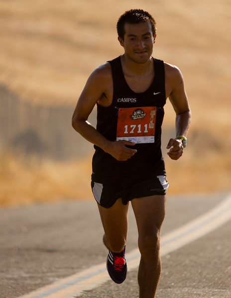 Fresno area runner Jesus Campos reaches the top of Rocky Hill during Saturday's Hell of a Half Marathon in Exeter. Campos would finish first overall in a time of  1:22:17.