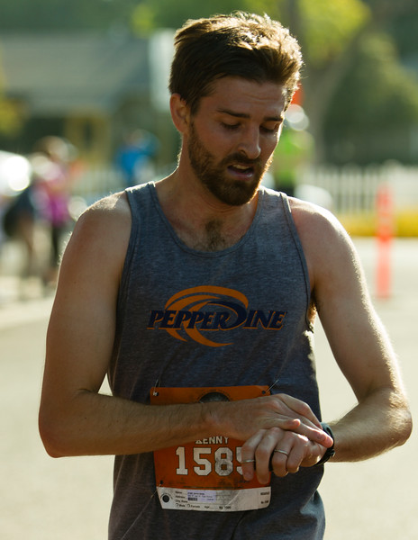 Kenny Smith, of Visalia, checks his time after completing the Hell of a Half Marathon in Exeter. Smith would finish 6th overall.