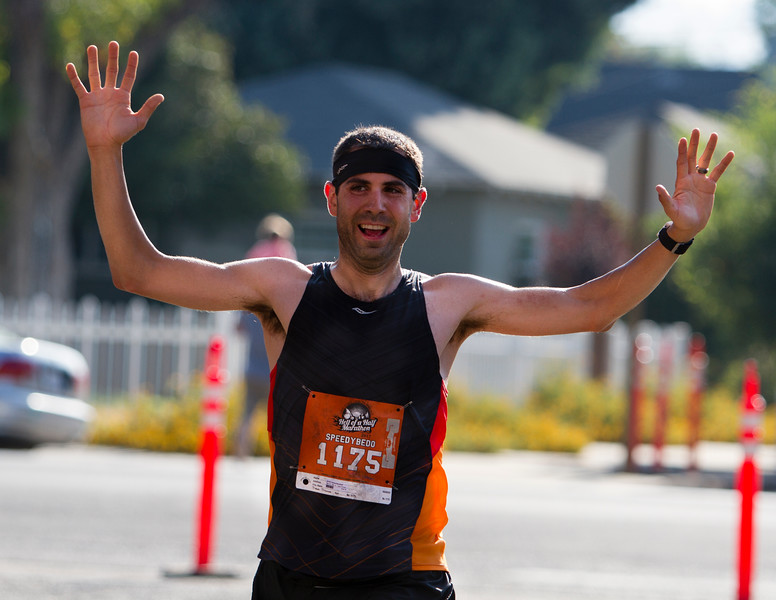 Joshua Escobedo, of Visalia, celebrate the completion of the 6th running of the Hell of  a Half Marathon held on Saturday in Exeter. Escobedo was the 5th place finisher overall.