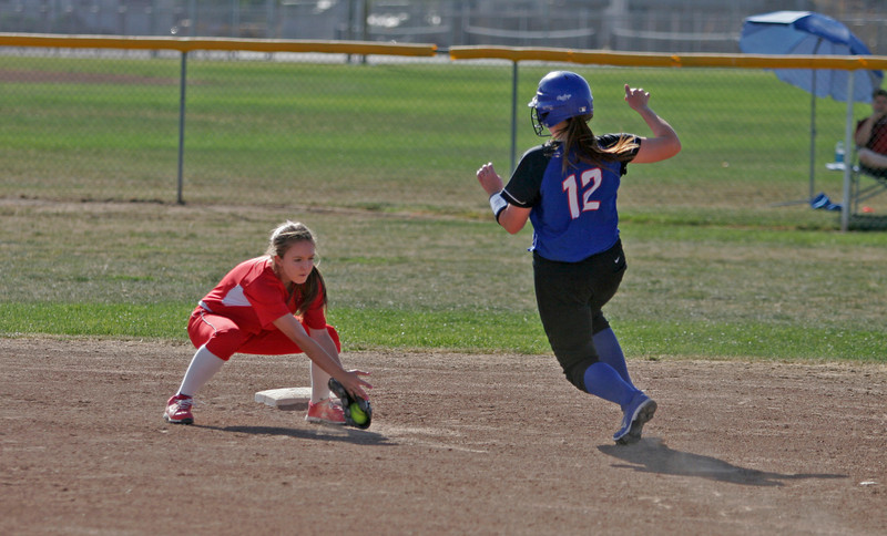Lindsay Cardinal SS Marissa Knutson is set to tag out Immanuel Eagle 1B Morgan Reynolds who attempted to stretch an outfield single into a double.
