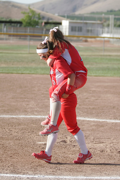 Lindsay Cardinal Destiny Garcia give Cardinal shortstop Marissa Knutson a lift after celebrating their 4-3 victory over Immanuel.