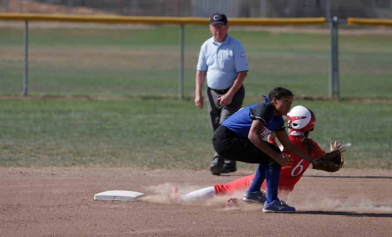 Lindsay Cardinal Center Fielder Destiny Garcia steals 2nd base early in the Cardinal play off contest against Immanuel. Garcia would score later in the inning.