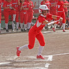Lindsay OF Destiny Garcia squares to bunt against Kern Valley on Friday. Kern Valley advanced with a 2-1  victory.