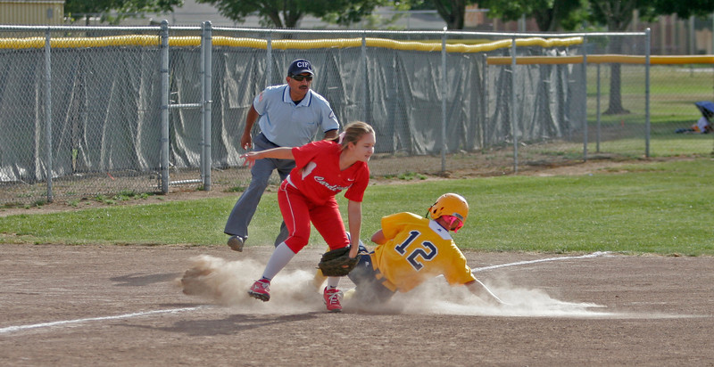 Lindsay Cardinal SS Marissa Knutson attempts a tag on Kern Valley Bronco Marayah Garza. The ball got by Knutson, but Garza ended the inning stranded at 3rd base.
