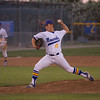 Exeter Monarch pitcher Tyler Rumbaugh (11) winds up a pitch against Kingsburg on Friday night. The Monarchs defeated the Vikings by a 3-0 score to capture the CSL title.