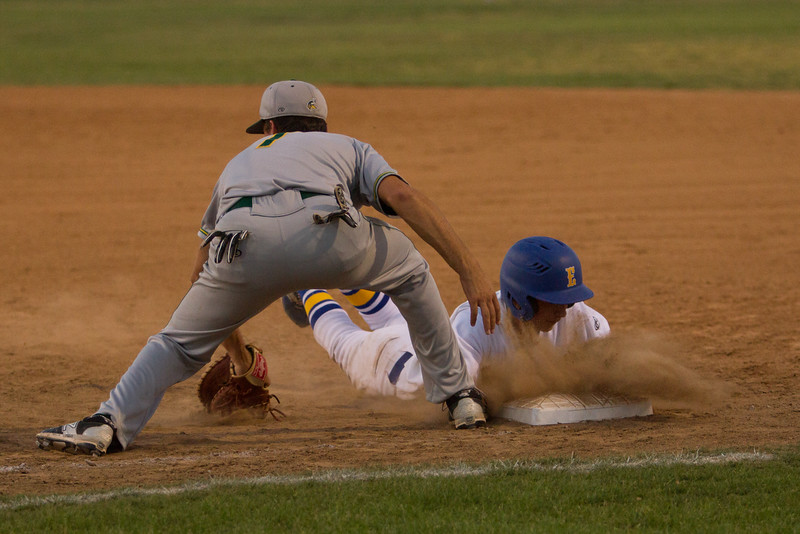 An Exeter Monarch base runner beats the throw to first in their Friday night contest against the Kingsburg Vikings. The Monarch clinched the CSL crown with a 3-0 victory.