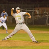 Brandon Perez (23) was one of the pitchers the Kingsburg Vikings brought on trying to stop the Exeter Monarchs on Friday night as an Exeter base runner takes a lead off first base. The Monarchs went on to a 3-0 win to clinch the CSL title.