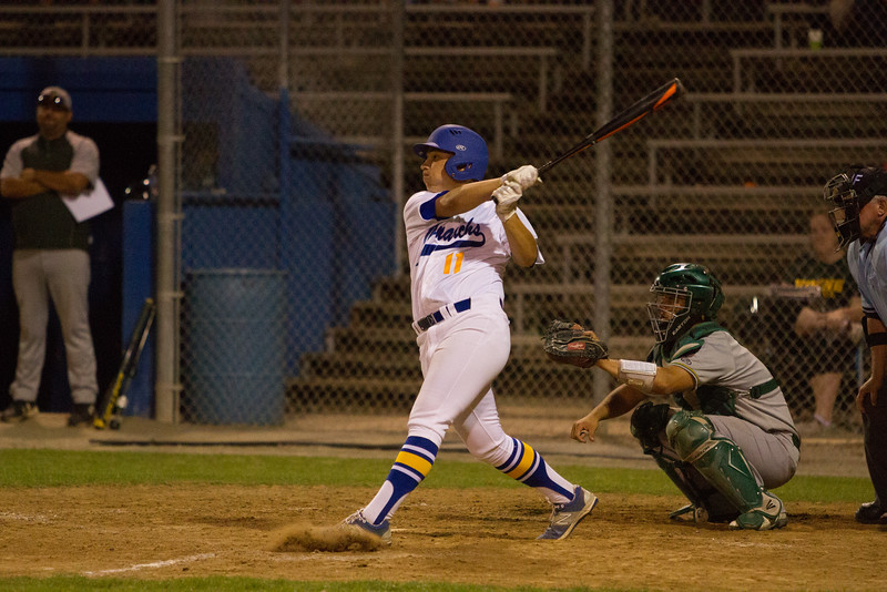 Exeter's Tyler Rumbaugh (11) takes a swing at a Kingsburg Viking pitch during their contest on Friday. The Monarch prevailed over the Vikings to improve their overall record to 21-5 and their league record to 11-2.