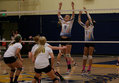 Olivia Harden (9) and Amanda Acosta (1) attempt to block a Kingsburg spike during Thursday's game. Exeter won 3-1.