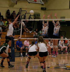 Exeter Monarchs Jacque Hutcheson (2) and Gabi Crookshanks (5) sky to block a Kingsburg spike.