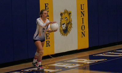 Jacque Hutcheson gets set to serve against Kingsburg on Thursday, October 17, 2013. Exeter won the match 3-1.