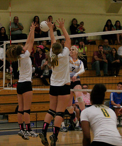 Exeter Monarch Chelsea  Larson (7) spike the ball against Kingsburg defenders on Thursday, October 17th.