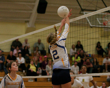 Exeter Monarch Jacque Hutcheson (2) spikes the ball against Kingsburg on Thursday, October 17, 2013.