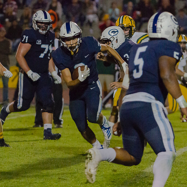 Noah Jiminez (3) advances a pass for the Central Valley Christian Cavaliers in Friday night action against Kingsburg. The Vikings would win by a 34-20 score to remain undefeated.