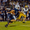 Central Valley Christian RB Jaalen Rening  (4) rushes the ball against Kingsburg Viking defender LB Cal Muxlow. The Cavaliers come up on the short end of a 34-20 score.
