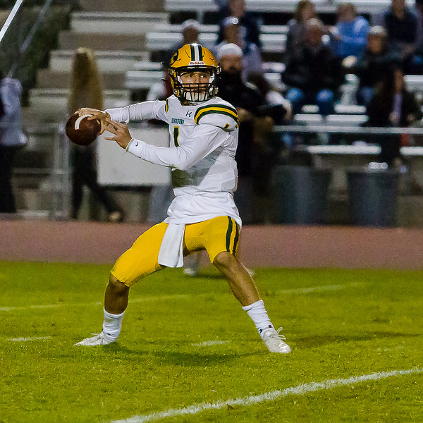 Kingsburg Viking QB Travis Hall (1) throws a pass in the Viking's 34-20 win  over Central Valley Christian in Central Sequoia League play.
