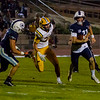 Central Valley Christian QB Tyce Griswold (11) tries to escape the rush of Kingsburg  LB Skyler White in CVC's  34-20 loss to the undefeated Vikings.