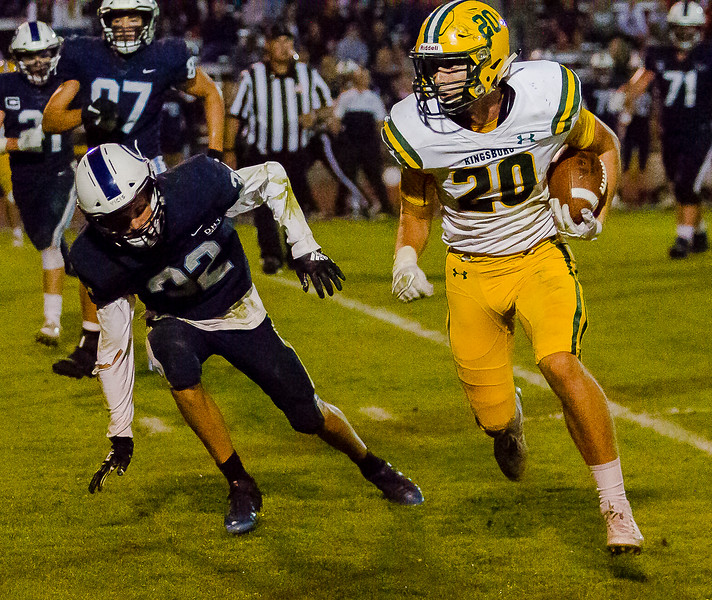 Kingsburg Viking TE Josh Jackson (20) turns up field against CVC defender David Lemstra (32) after catching a pass. The Vikings would defeat the Cavaliers 34-20.