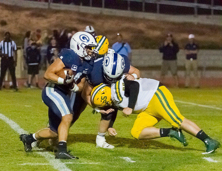 Central Valley Christian RB Jaalen Rening rushes the football against Kingsburg DT Daemond Contreras (55) in Friday night's CSL play. Kingsburg would win by a 34-20 to remain undefeated.