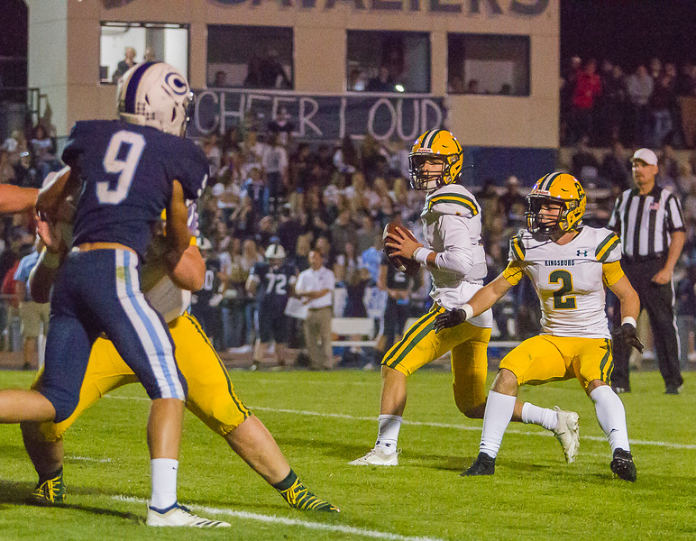 Kingsburg High Viking QB Travis Hall (1) scans the field as running back Blake Spomer  (2) defends against the rush in CSL play. The Vikings would  go on to defeat the Cavaliers by a 34-20 score.
