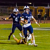 Central Valley Christian QB Tyce Griswold (11) scrambles to avoid the Kingburg rush. Kingsburg would win 34-20 to remain undefeated.