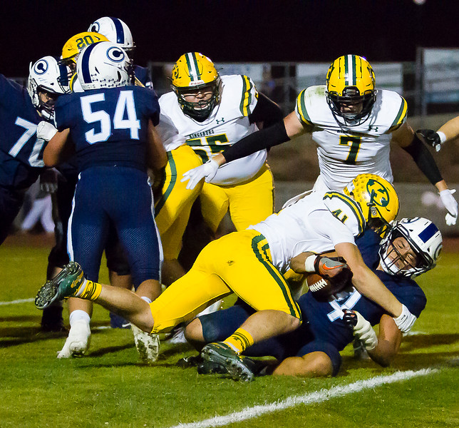 Central Valley Christian RB Jaalen Rening (4) is tackled by Kingsburg Viking LB Cal Muxlow in Central Sequoia League action. Kingsburg would defeat CVC by a 34-20 score to remain undefeated.