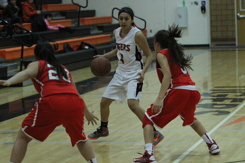 The Lindsay Cardinals defeat the Woodlake Tigers 58 - 46 in ESL league play on January 20th.