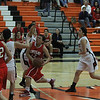 The Lindsay Cardinals defeat the Woodlake Tigers 58 - 46 in ESL league play on January 20th. Janessa Martinez (12) drive the paint for 2 of her 4 points against Woodlake.