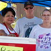 Lindsay Chamber of Commerce members (l to r) Virginia Loya, Craig Dimmitt, and Sharon Dimmitt volunteer at the beer booth during the Lindsay CofC Car Show.