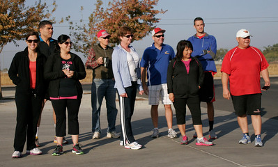 Participants in the 2-mile walk at the Awareness Walk during the Lindsay Heath & Fitness Fair get ready to begin.