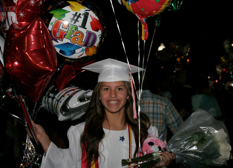 Lindsay High School graduate Destiny Garcia shows off the many gifts she received at the Cardinal's 2014 Commencement Ceremony.