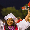 Lindsay High School held its 2015 Graduation Ceremony on Friday, June 12, 2015. A Lindsay High School graduate celebrates a she leaves the stadium.