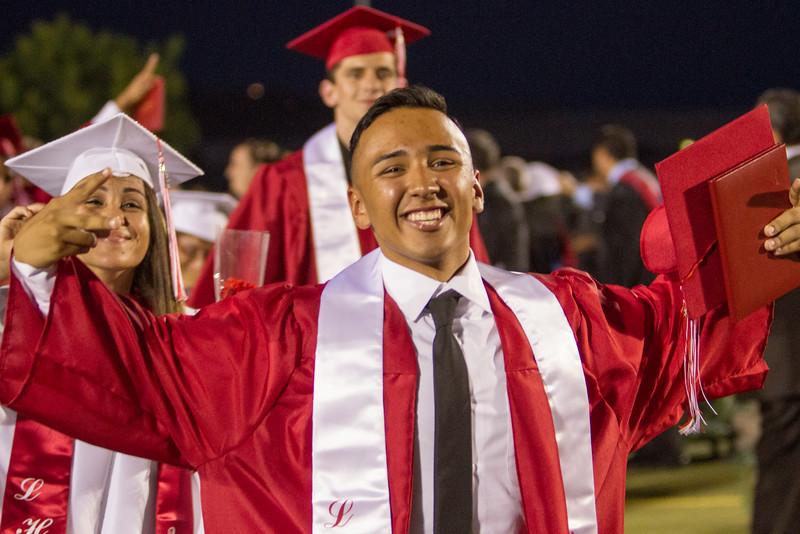 Lindsay High School held its 2015 Graduation Ceremony on Friday, June 12, 2015. A new Lindsay High School graduate celebrates his accomplishment as he leave the ceremony.