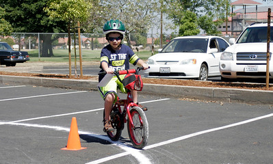 Jacob Thullen (6) rides a figure eight at the Lindsay Kiwanis Bicycle Rodeo on Saturday, June 15, 2013.