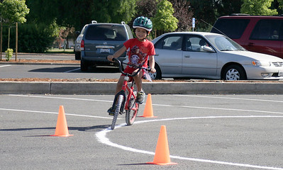 Enrique Rodiguez Reyes, age 5, complete a figure eight at the Linsday Kiwanis Bike Rodeo on Saturday, June 15, 2013.