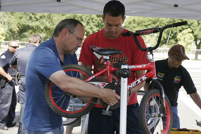 Members of the Lindsay Kiwanis and volunteers tuning up a participant's bicycle at the Lindsay Bicycle Rodeo on Saturday, June 15, 2013.