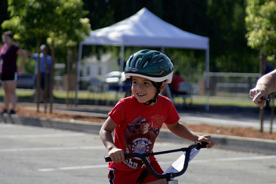 Enrique Rodriguez Reyes, age 5, sports a new bicycle helmet given to each cyclist who participated in the Lindsay Kiwanis Bike Rodeo on June 15, 2013.