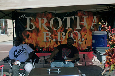 The Brotha B.B.Q. relaxing at the Lindsay Rib Cook Off as their ribs cook.