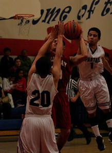 Strathmore Spartan guard Eric Lopez attempts to block a Cardinal shot during their contest on Friday.