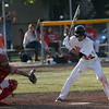 Woodlake Tiger Scotty Baker looks at a pitch during the Tiger's 13-2 victory over the Cardinal's on April 4th.