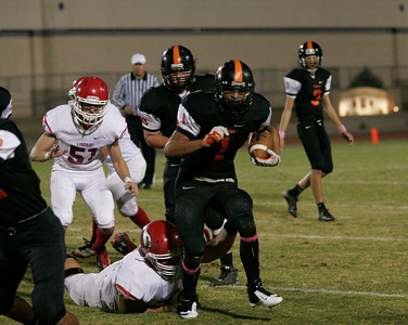 Woodlake Tiger Elijah Cunningham rushes the ball against Lindsay in Friday's 28-0 loss to the Cardinals.