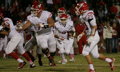 Lindsay Cardinal runningback Jacob Hernandez (21) with a group of blockers including Marcus Nunez (55), Chris Misaalefua (74) and Angel Cortes (20) early in Lindsay's 28-0 defeat of the Woodlake Tigers.