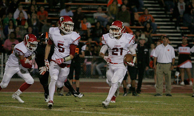 Lindsay Cardinal WR Gaven Mann (5) leads running back Jacob Hernandez (21) in Friday's 28-0 win over the Woodlake Tigers.